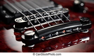 Extreme close-up of an electric guitar. Macro pickups,...