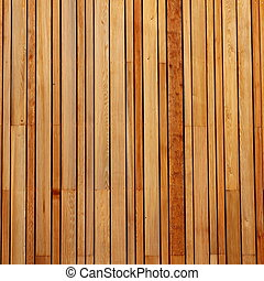 Wood Cladding - Vertical pattern of wood cladding on a...