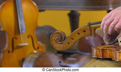 a luthier repairs a cello - The luthier sets up four key...