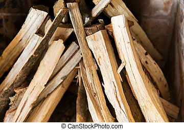 close up of firewood in fireplace - heating, warmth and...