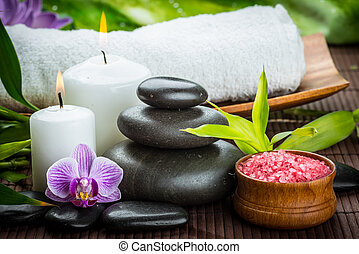 spa concept with zen basalt stones and salt