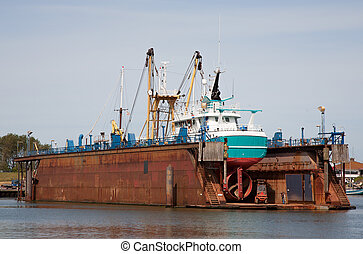 Dry dock, - Trawler in a dry dock in Den Burg, Texel, the...