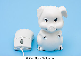 Internet Banking - A computer mouse with a piggy bank on a...