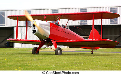 Red biplane - Classic red biplane, ready for take-off