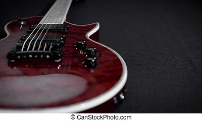 red electro guitar play rock music instrument. Black...