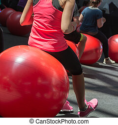 Closeup of  Girl doing Fitness Activity Sitting on Big Red Ball