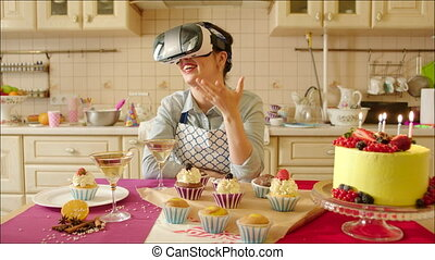 Pastry Chef in VR Glasses - Young smiling pastry chef is...