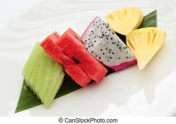 slices of watermelon and fruits