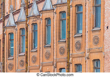 Windows in a row on facade of apartment building