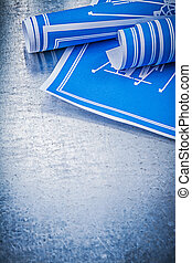 Set of blue engineering drawings on metallic background construc