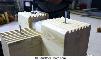 Worker makes blank for construction of glulam - Worker makes...