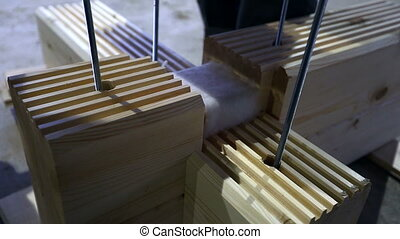 Glued laminated timber coupling and insulate - View of glued...