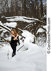 Fashion model  in winter wood