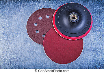 Sanding discs holder on metallic background directly above