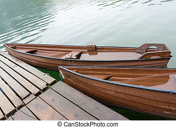 Wooden boats at pier - Wooden boats filled with water at...