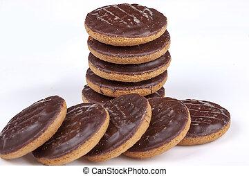 Jaffa cakes - Pile of chocolate coated jaffa cakes on a...