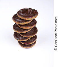 Jaffa cakes - Pile of chocolate coated jaffa cakes with a...