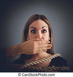 Mobbing concept - Man covering mouth to a woman tied