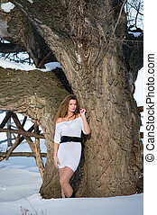 Fashion model in winter forest