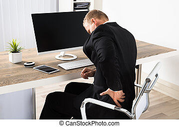Businessman Suffering From Backpain - Young Businessman...