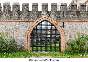Gate of an old medieval castle - arched entrance of a...