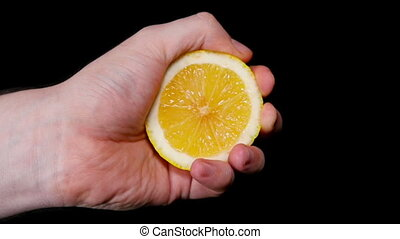 Man's Hand Squeezing Lemon