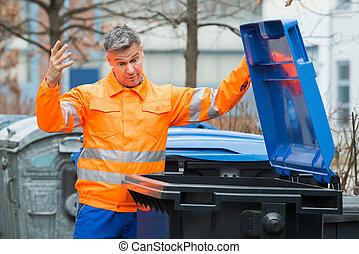 Street Cleaner Looking In Dustbin - Unhappy Male Street...