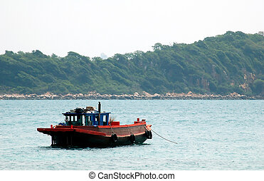 Boat - A fishing-boat float on the sea in Pattaya Thailand