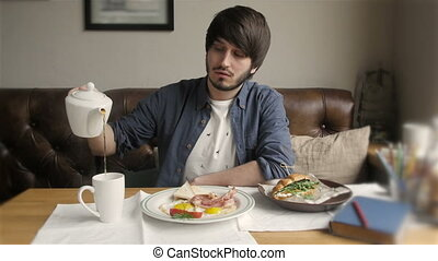 Cinemagraph of Young Handsome Man Serving Tea in Modern Cafe