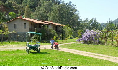 quot;Father pushing baby carriage countryside, parent his...