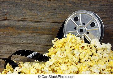 vintage movie reel and popcorn - Vintage movie reel and film...