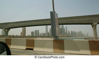 View from the window of a moving car at Dubai