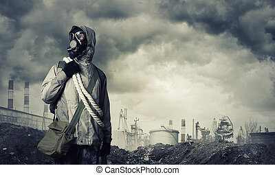 Post apocalyptic future - Man survivor in gas mask on...