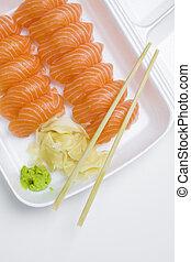 take-away box of sushi - plastic white take-away box of...