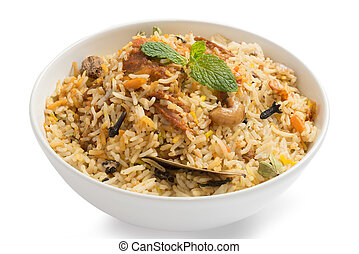 Yummy delicious chicken biryani in a round bowl
