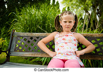 Offended girl - Portrait of small offended child - outoor in...