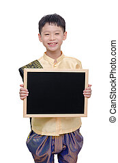 Young boy smiling with chalkboard