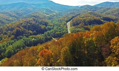 Autumn mountains - Flying over the mountains, river at...
