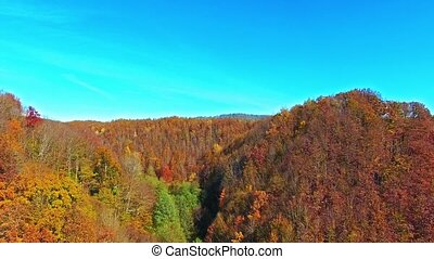 Autumn mountains. - Flying over the mountains, river at...