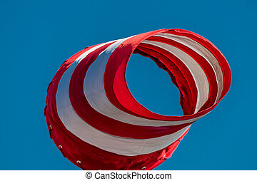 windsock against blue sky - a windsock inflated by the wind...