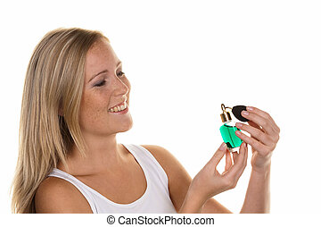 young woman with perfume bottle - a young woman with a...