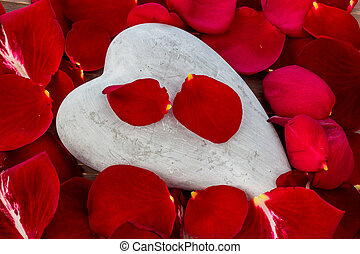 red roses with heart love for valentines day - on a stone in...