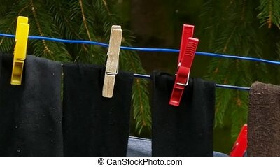 Socks on Clothesline Rope with Clot - Grey and black socks...