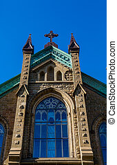 Blue Window at Top of Church - Old Stone Church in...