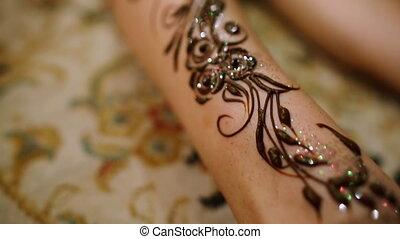 Mehndi. Henna pattern on model's foot.