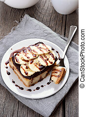 Banana cheese cake with chocolate syrup, country style