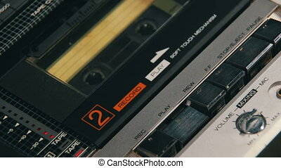 Pushing a Finger Play and Stop Button on a Tape Recorder -...