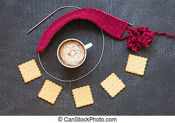 Ped knitting, cup of coffee and crackers - Knitting with red...