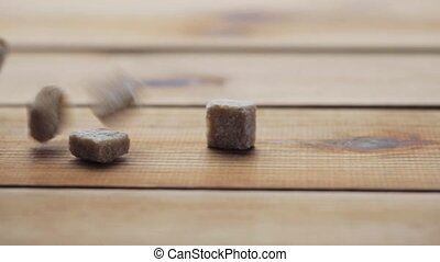 close up of brown sugar on wooden board or table - food,...