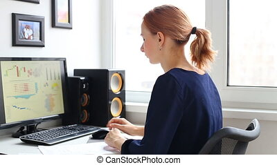 Woman working with computer in office